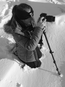 Jade Harris working on her photography skills with her Nikon in black and white.